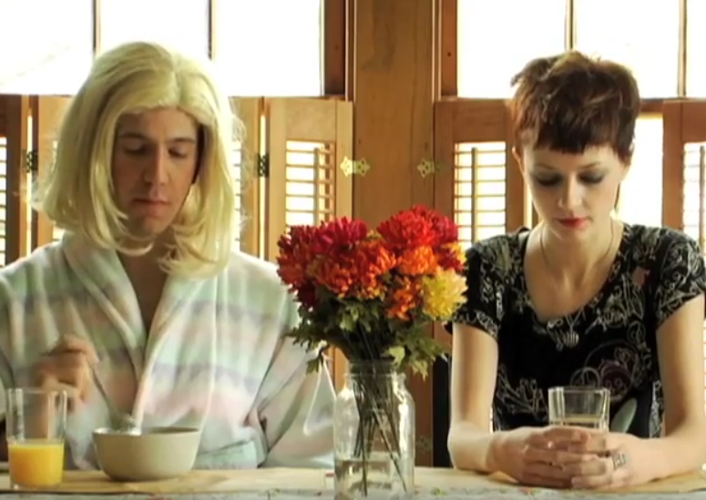 A still from the internet porn skit from T.H.I.S. Rob is in a wig, as the mom.