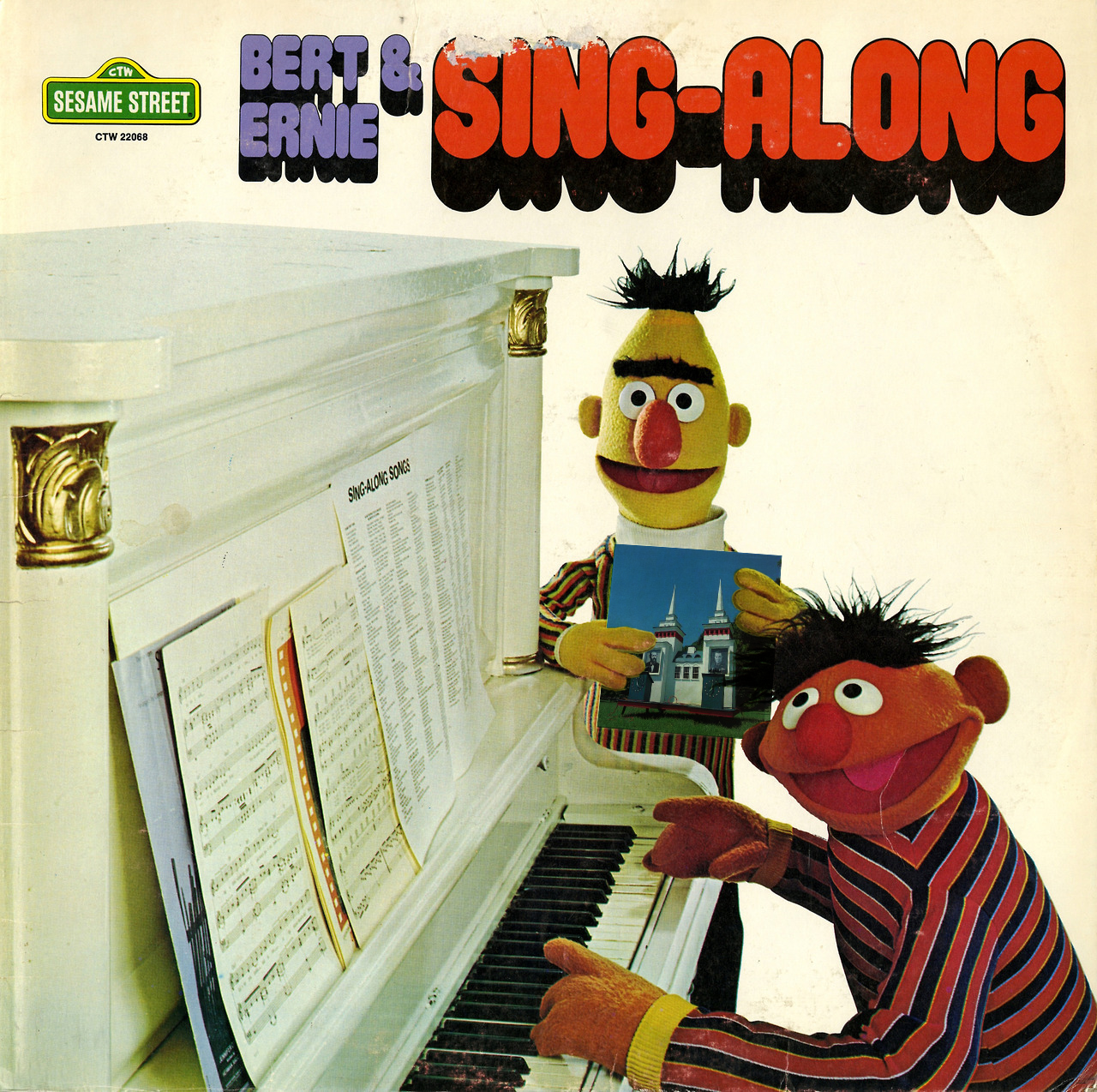 Ernie plays piano and Bert holds a copy of the album Lincoln.