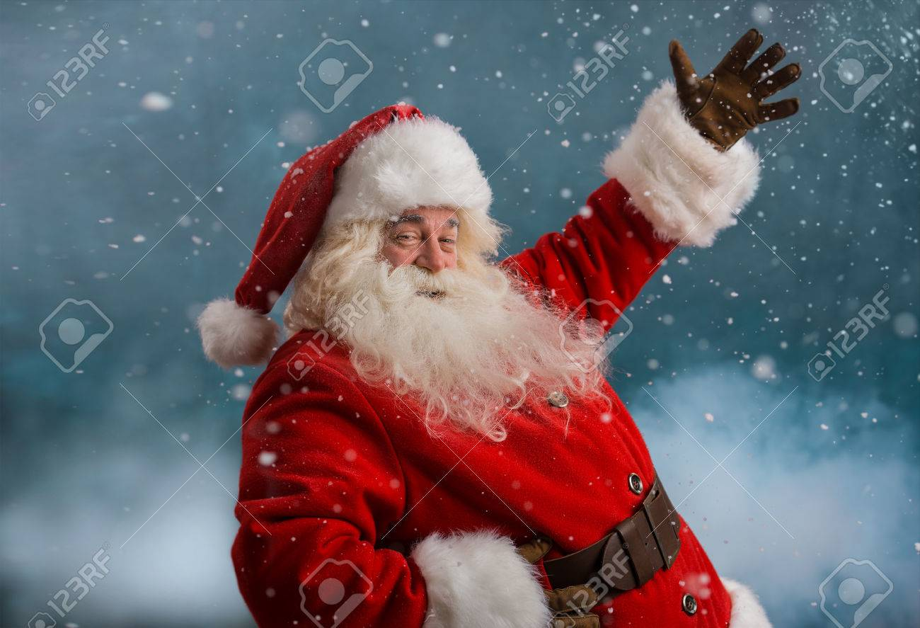 31532984-happy-santa-claus-laughing-while-standing-outdoors-at-north-pole.png