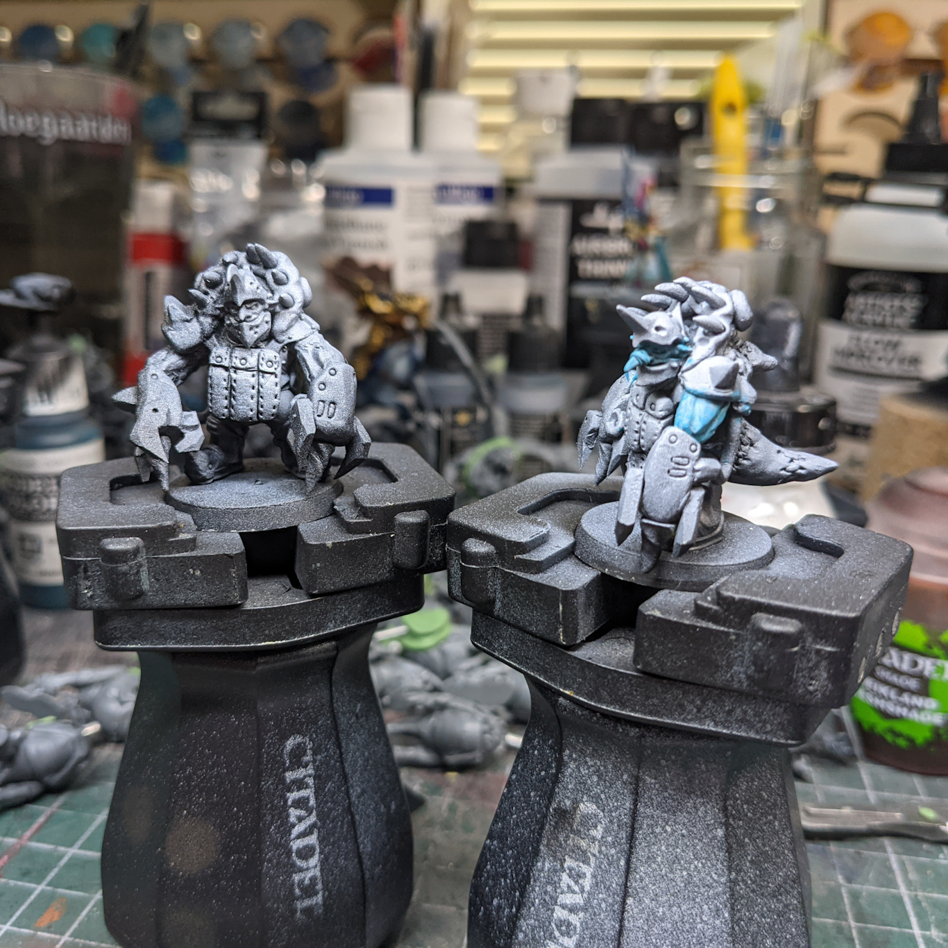 Two-partly painted Goblin models, wearing heavy armour and equipped with huge claws.