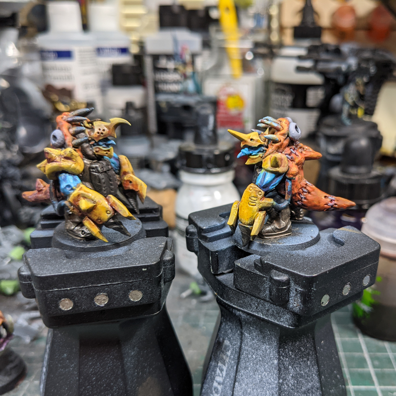 Two converted model Squig Bosses, goblins in yellow exo-suits and fake squig outfits.