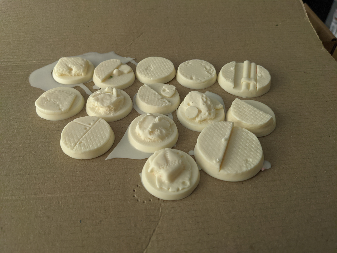 A set of moulded bases for models, in a pale cream colour like white chocolate