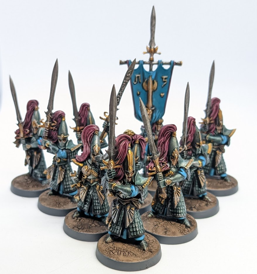 A unit of Swordmasters: Elves carrying greatswords, wearing ornate armour and tall plumed helmets.