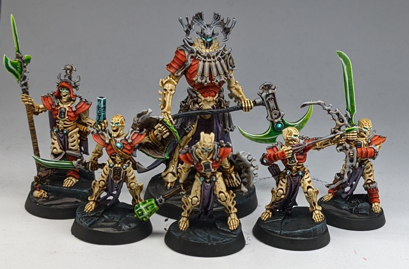 A unit of six Ossiarch Bonereapers, skeletal warriors wearing red armour.