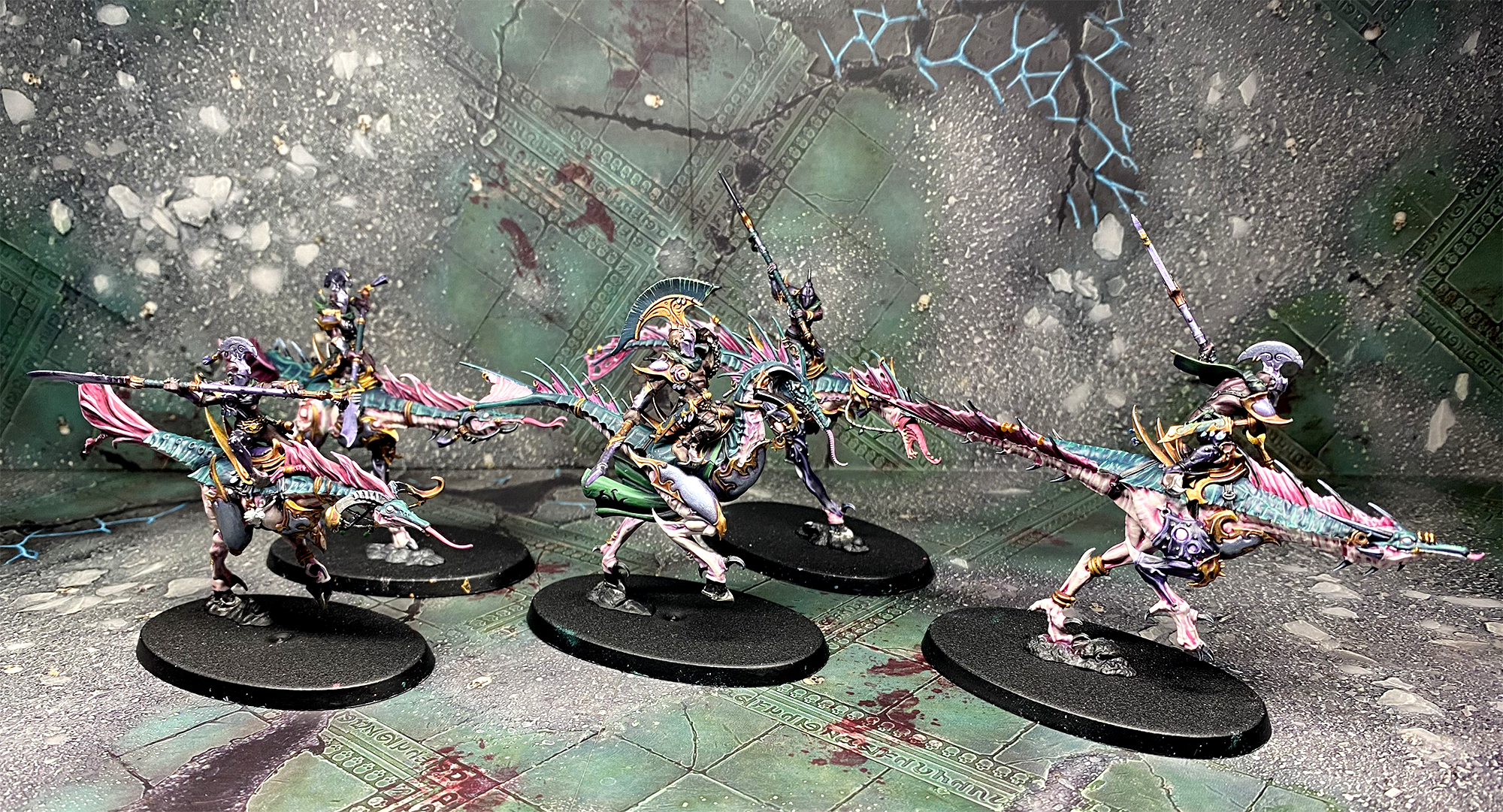 Five model Slick Blade Seekers, ornately armoured warriors mounted on strange bipedal beasts, painted in pale pinks and blues.