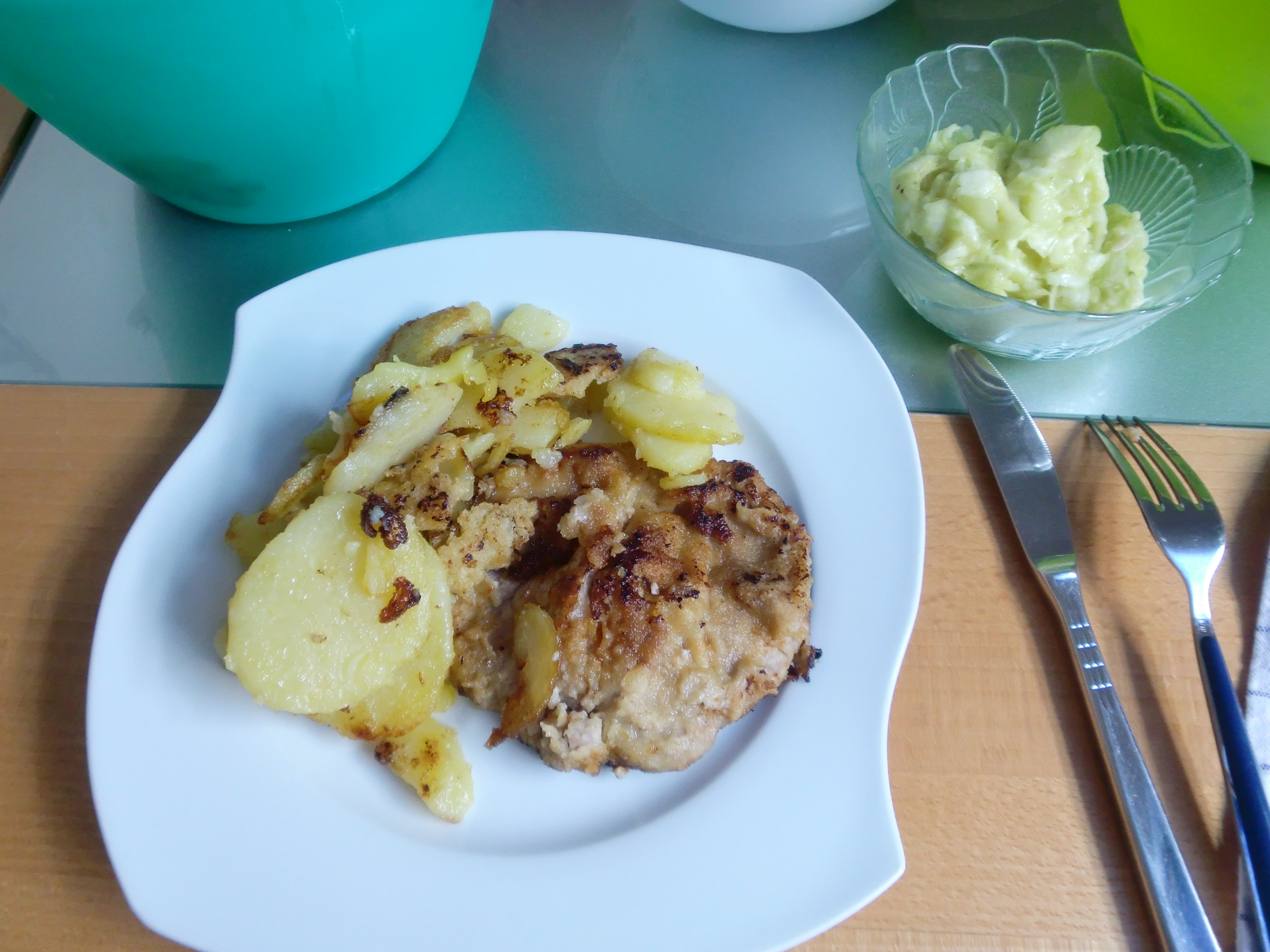 Schnitzel, chipped potatoes and cucumber salad