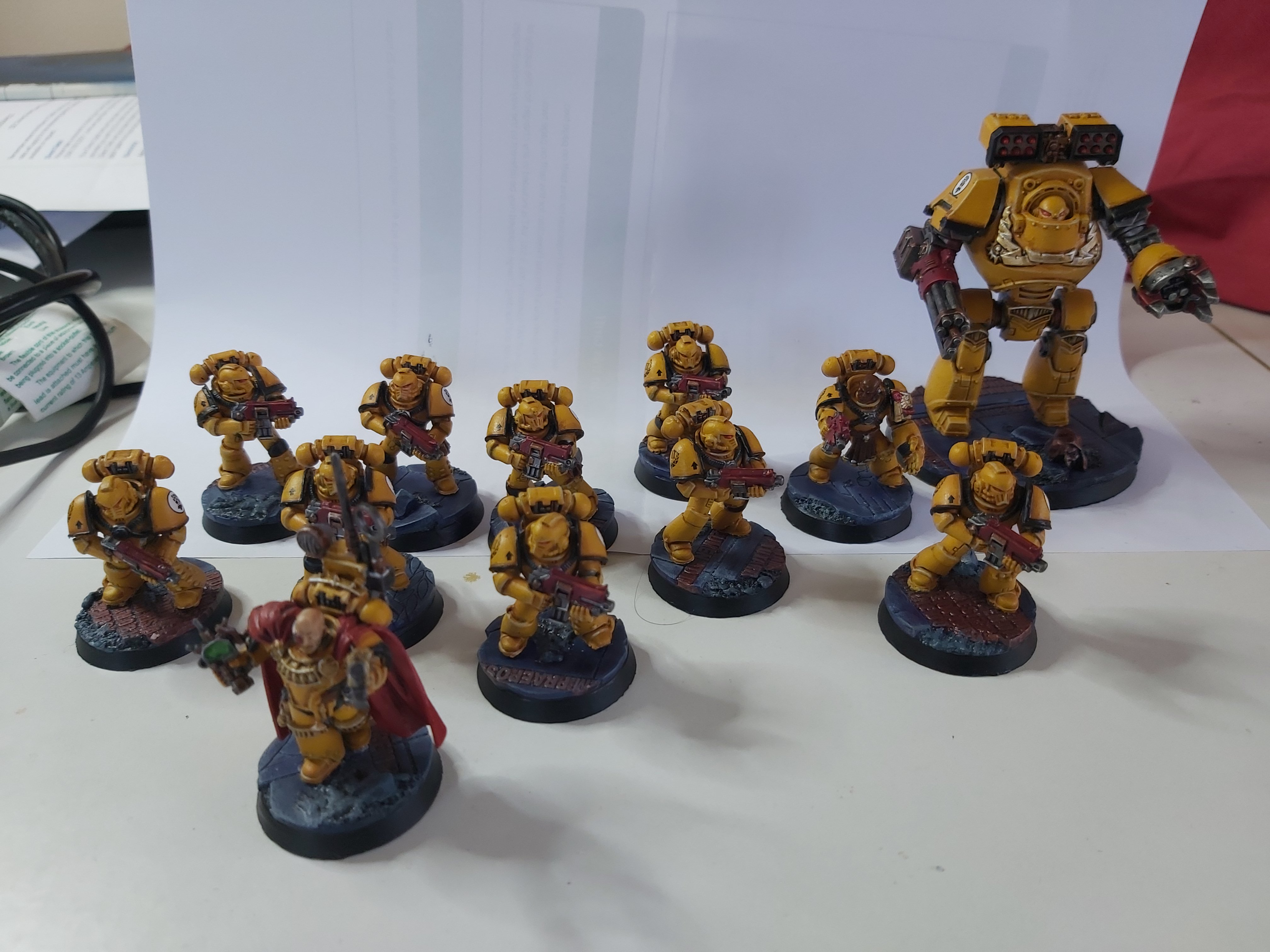 A small force of Imperial Fists, yellow and black armoured space marines on blue bases