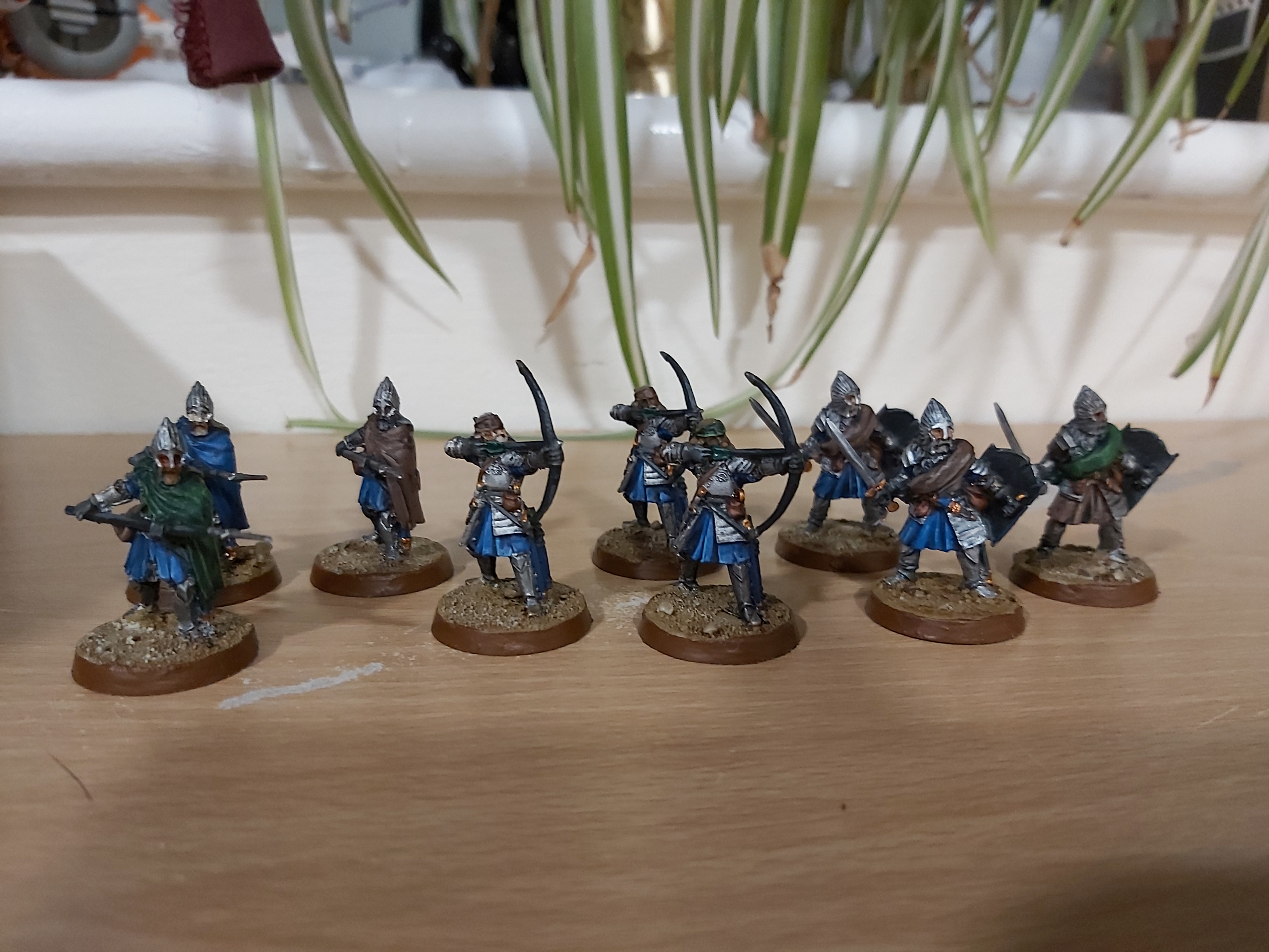 A group of model soldiers, with battered armour and tattered cloaks.