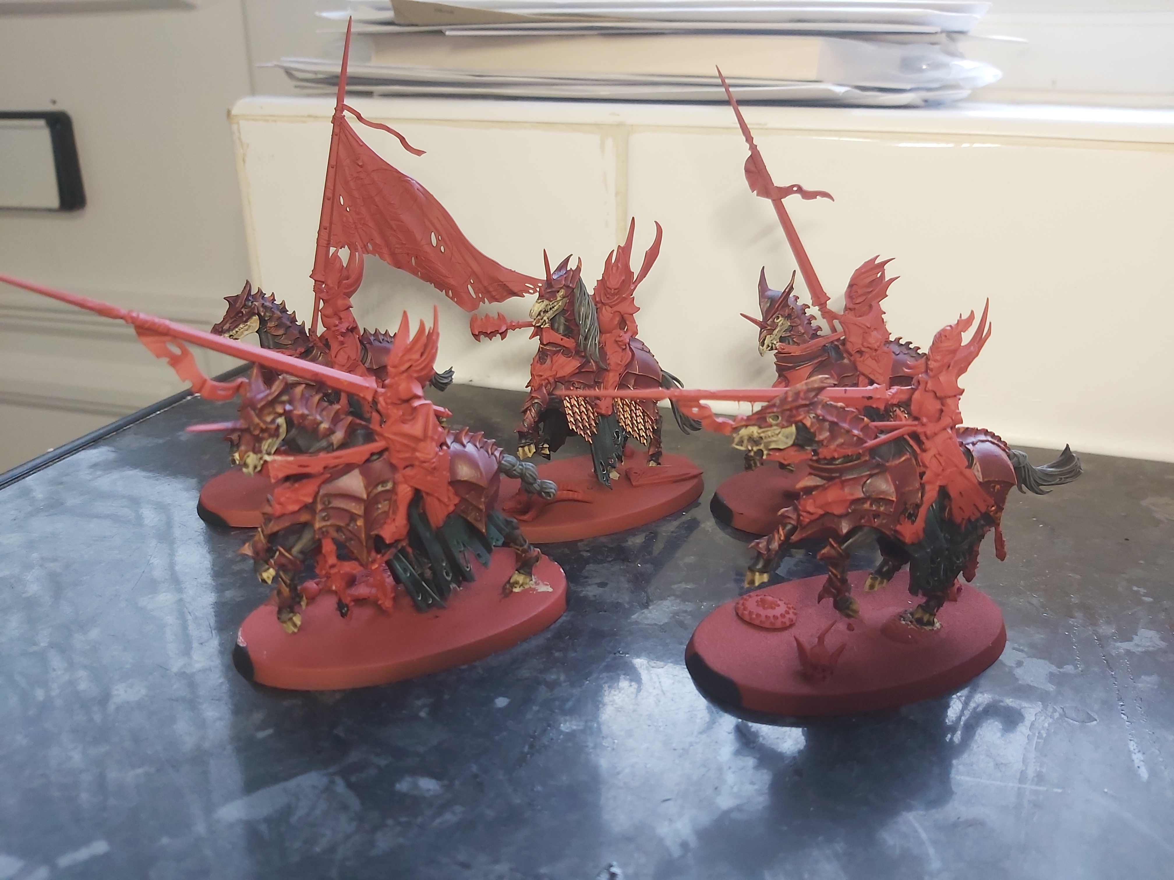 Five model Blood Knights, heavily armoured vampires bearing lances and riding skeletal steeds.