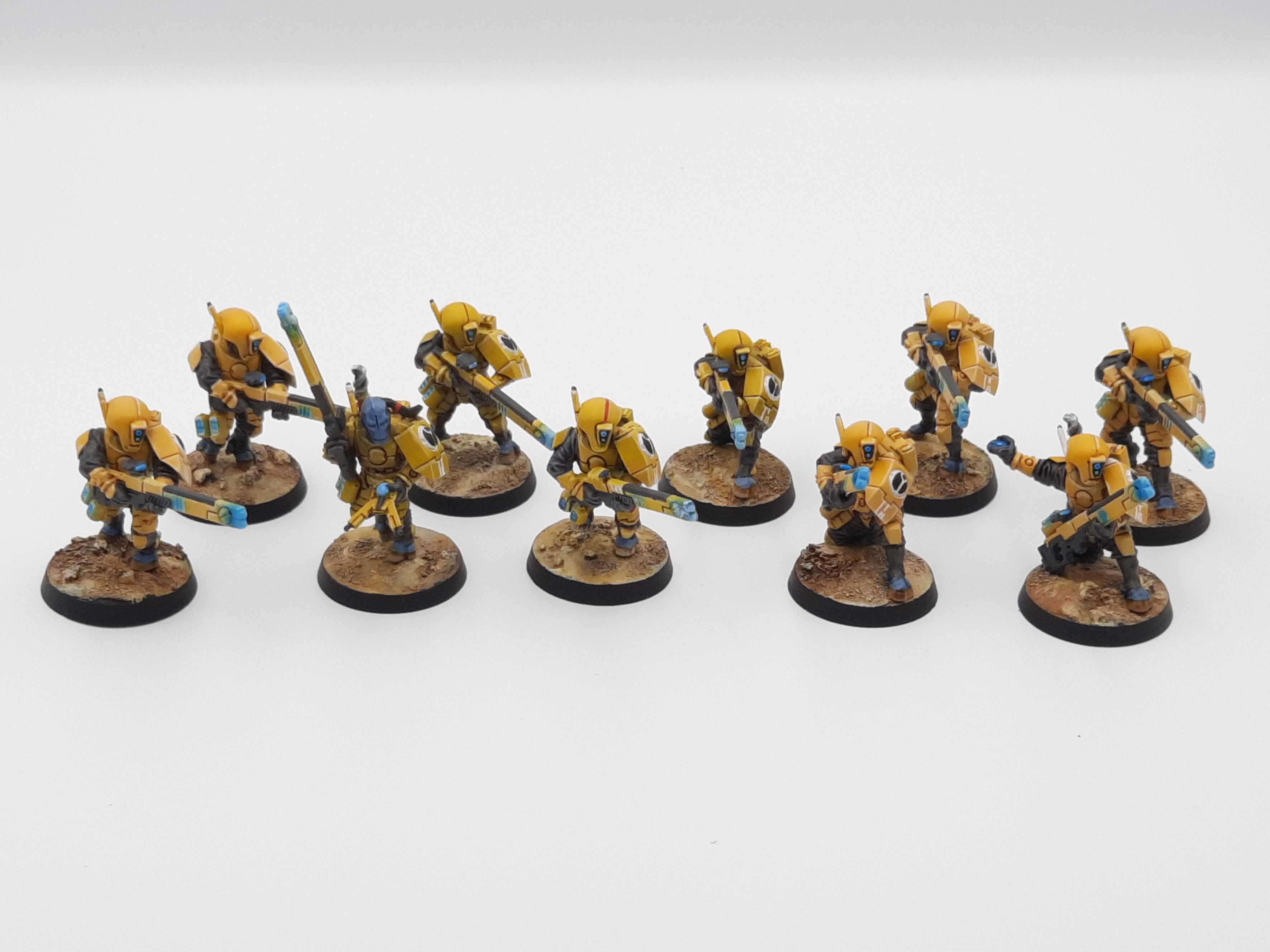 A squadron of Fire Warriors, lightly armoured alien fighters with long-barreled laser guns.