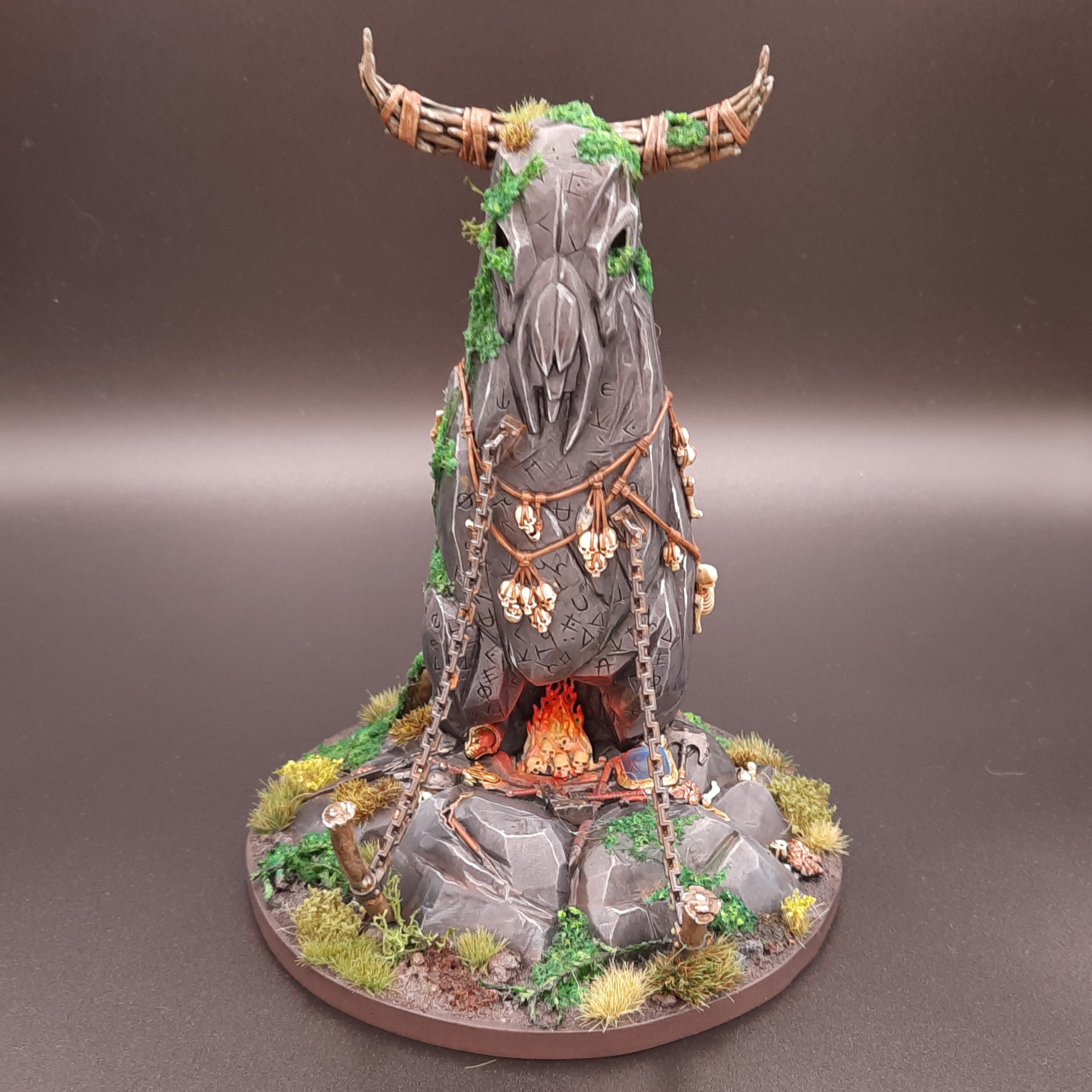 A model herdstone, an ancient monolith carved like a beast's skull